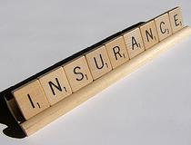 """insurance"" spelled with scrabble letters"